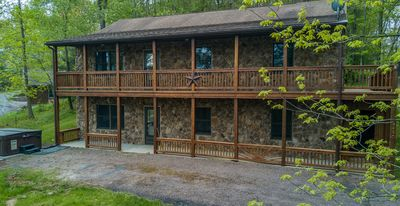 Photo for 2 covered decks & a central location with seasonal lake views!