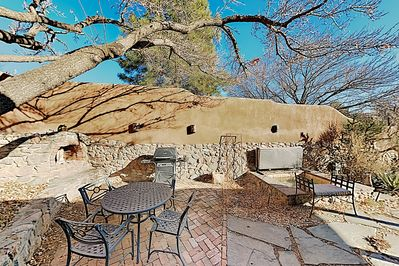 Courtyard - Your private stone courtyard features a hot tub, plus everything you need for an alfresco cookout.