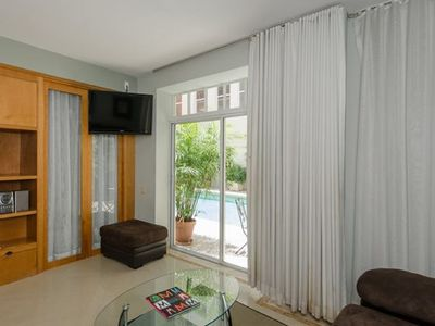 Photo for Updated 1 bedroom w/ WALK OUT TO POOL- Walk to BEACH