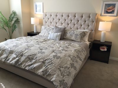 """master bedroom with king bed, 45"""" HDTV,  cable box"""