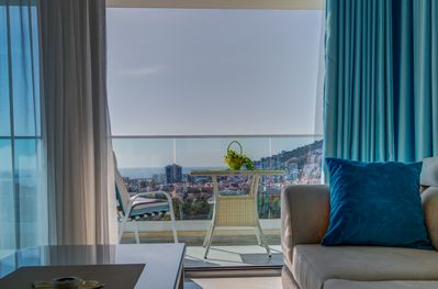 Living Room with Sea and City View