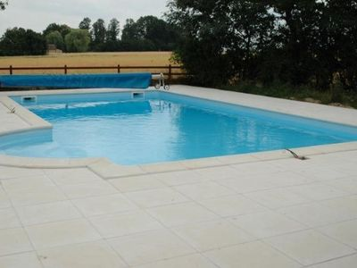 Photo for Renovated farmhouse in peaceful countryside with heated pool