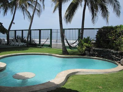 Pool view looking out to ocean. Pool seating & table for entertaining.
