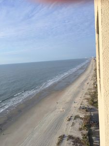 Photo for RIGHT ON THE BEACH Newly Updated Condo, Near Airport,Wifi, Covered Parking