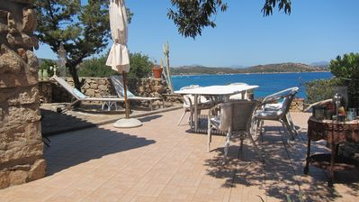 Photo for Water Front Villa and Private Guest Cottage, beach just 50 meters away!