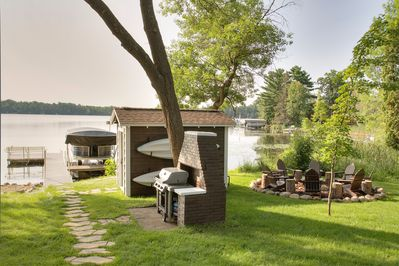 Grilling area, fire pit, kayaks (free use with rental) and storage shed