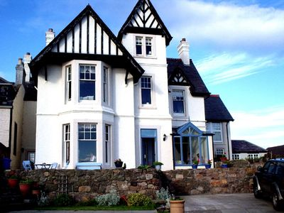 Dalmore with wonderful views over the beach,  harbour and the bay beyond