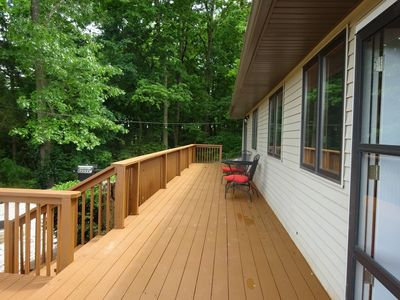 The deck runs the whole length of the house.