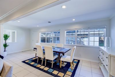 Dining Accommodations For 6 Near Wall Of Windows