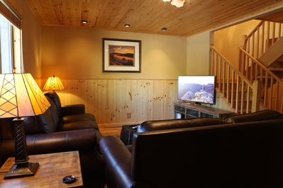 living room is beautifully furnished with brand new leather sofa, love seat & flat screen TV