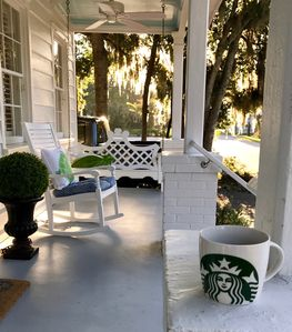 Front porch rocker and swings are a great place to enjoy relaxing morning coffee