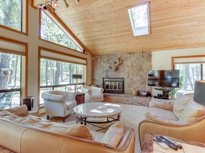 Photo for Contemporary home w/ deck, on-site golf, shared pool, hot tubs, & sauna!