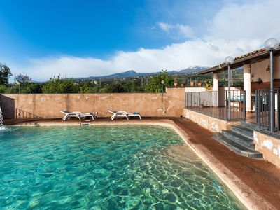 Photo for Charming villa with PRIVATE POOL, blossoming garden and sea & Etna views.