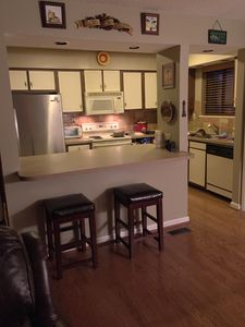 Kitchen with new microwave, oven, stove, refrigerator, coffee maker