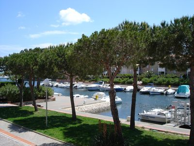 Photo for Stunning view over marina with beach and shops close by