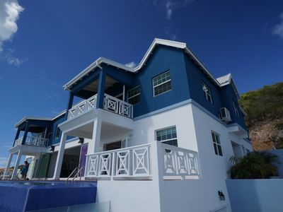 Photo for Hillside villa.  Amazing villa overlooking beach, panoramic views built 2012