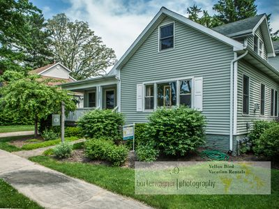 Photo for Dog friendly,  short walk to downtown, huge yard, hot tub, walk to the beach!