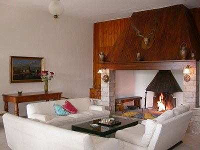 the sitting room and the huge fireplace