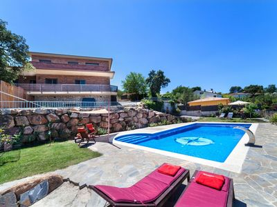 Photo for This 5-bedroom villa for up to 10 guests is located in Tordera and has a private swimming pool and W