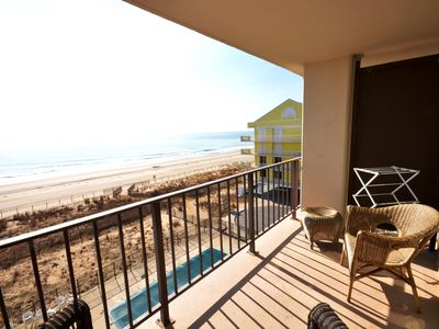 Photo for Comfortable 2 bedroom oceanfront condo with free WiFi, an outdoor pool, and balcony with an amazing ocean view located midtown just steps to the beach!