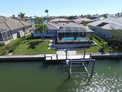Photo for Waterfront Home, Heated Pool, Boat Lift, Beautifully Decorated, Lanai, Wifi