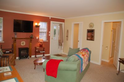 Open plan living and dining room with electric fireplace & flat screen TV & WIFI