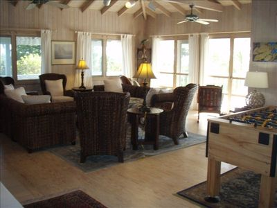 Spacious upper level living room with views or the Atlantic Ocean