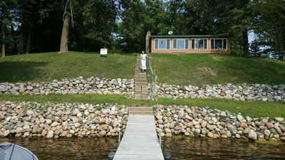 Steps from lake up to cabin