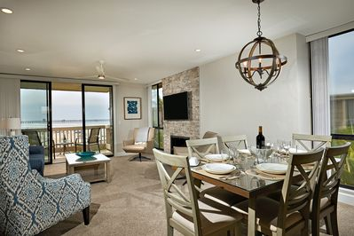 The dining and living areas of Coastal Cottage look down the beach to the Oceanside Pier.