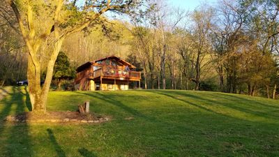 Large open front yard with plenty of room to relax and enjoy the river views.