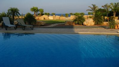 Photo for LIMONIA - Luxury beach front villa by Blue Flag beach accommodating 12 (+1 child