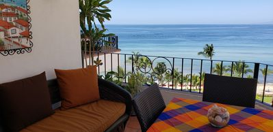 Your magnificent view from the large balcony. sounds of the beach.