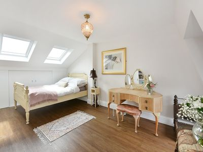 Photo for Light-filled bedroom with ensuite in a family home