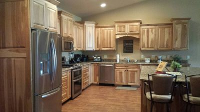 Kitchen with plenty of cabinet space,a large island,& stainless steel appliances