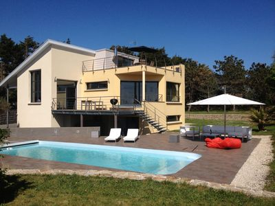 Photo for PROMO! 9-19 .07 Contemporary sea view villa with heated pool