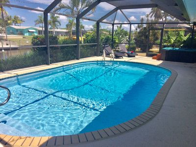 Photo for Tropical Paradise - heated Pool - Hot Tub - Directaccess