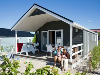 Photo for Beautiful lodges, situated almost directly on the beach next to unique park
