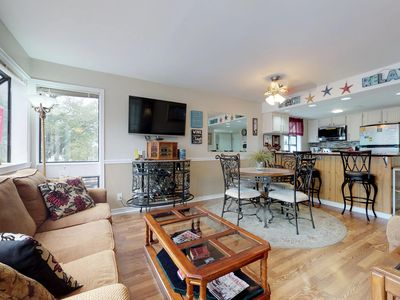 Photo for Renovated snowbird friendly condo with shared pool, hot tubs, & near beach!