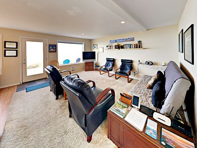 Living Area - The living room offers comfortable seating for pre-dinner drinks or unwinding with a movie.