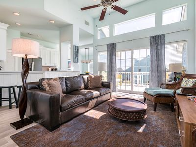 Photo for Sunny and dog-friendly condo with furnished decks - close to the beach!