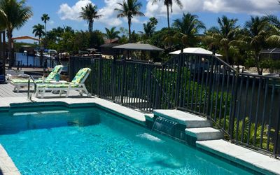 Photo for The Blue Lagoon with heated pool /on the Canal with NEW Boat Lift and Dock
