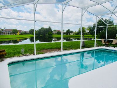 Photo for Spacious 4 bed/3 bath Disney Home with South Facing Pool and Lake View
