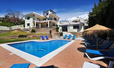 Photo for 6 bedroom Villa, sleeps 15 with Pool, Air Con, FREE WiFi and Walk to Shops