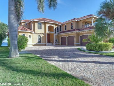 Photo for directly located on the river** top location** huge house and pool