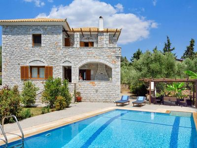 Photo for In the perfect spot for rest and relaxation, Meli is a five minute drive from Methoni beach and local amenities.  Built in the local stone,  this comfortable house has a pretty garden with a barbecue on hand for real outdoor living