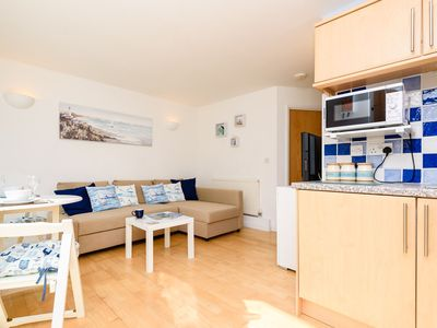 Photo for Modern apartment for four, close to the beach with free parking and wifi