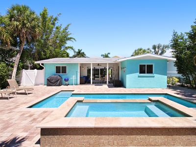 Photo for Dog-friendly family house w/ private pool, lanai & an easy walk to the beach!