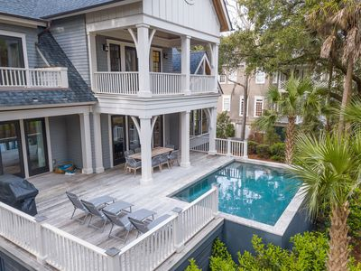 Photo for Professionally decorated, gorgeous, private pool and close to beach access