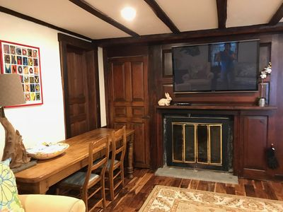 dining/ work table, fireplace, TV with FIOS, closet