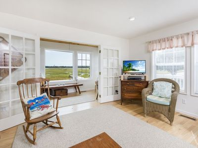 Photo for Enjoy incredible Views of Assateague Channel & the Lighthouse from this one-of-a-kind 3 Bedroom Home
